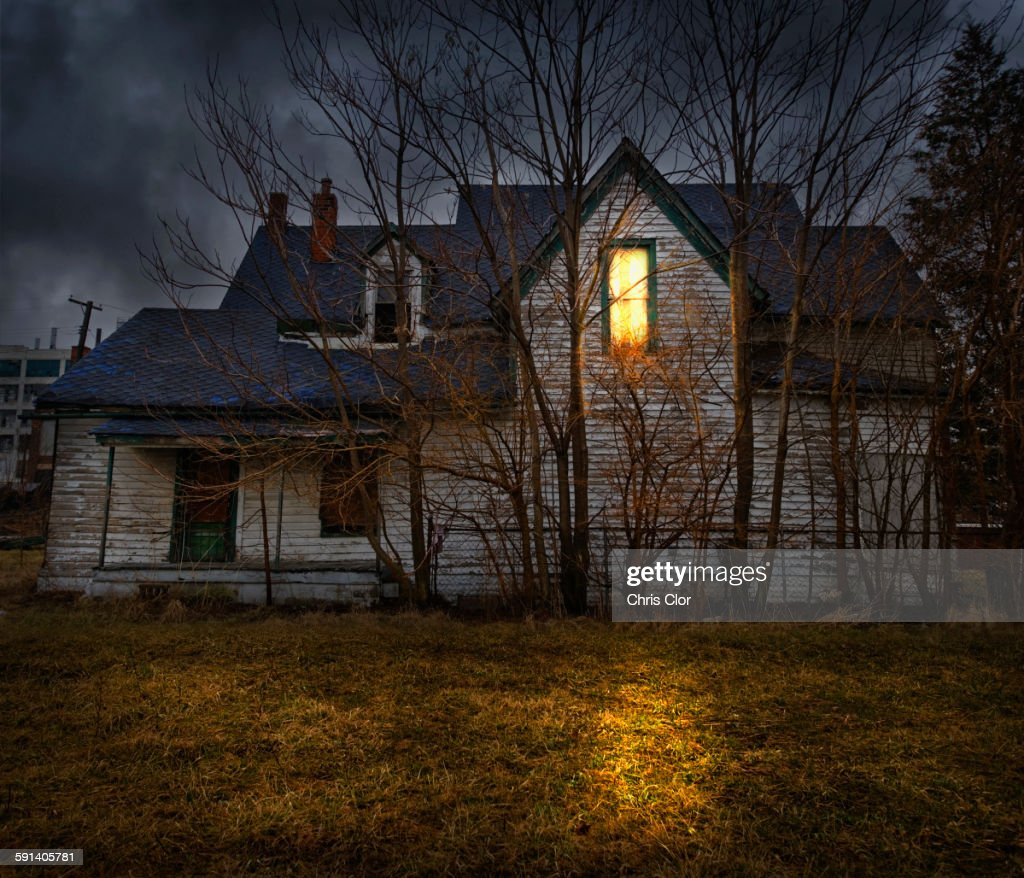 glowing window casting light in backyard stock photo getty images