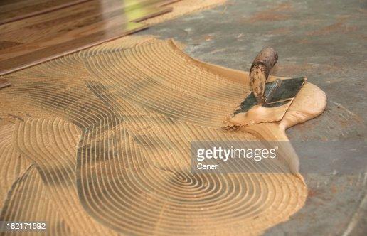 Glued down hardwood floor: Thinset mortar and trowel