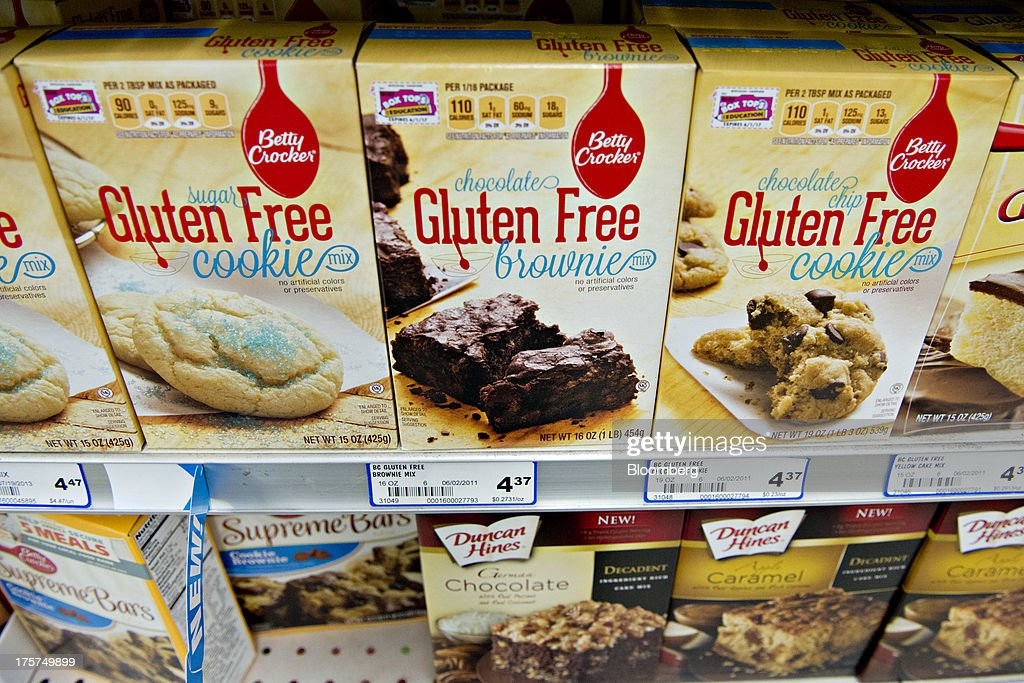 'Gluten free' appears on the packaging for General Mills Inc. Betty Crocker brand cookie and brownie mix displayed for sale at a supermarket in Princeton, Illinois, U.S., on Wednesday, Aug. 7, 2013. The Food and Drug Administration (FDA) is issuing a final rule to define the term 'gluten-free' when voluntarily used in food labeling, according to a notice published in the Aug. 5 Federal Register. Photographer: Daniel Acker/Bloomberg via Getty Images