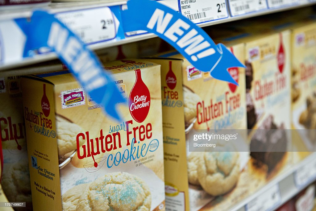 'Gluten Free' appears on the packaging for General Mills Inc. Betty Crocker brand cookie mix displayed for sale at a supermarket in Princeton, Illinois, U.S., on Wednesday, Aug. 7, 2013. The Food and Drug Administration (FDA) is issuing a final rule to define the term 'gluten-free' when voluntarily used in food labeling, according to a notice published in the Aug. 5 Federal Register. Photographer: Daniel Acker/Bloomberg via Getty Images
