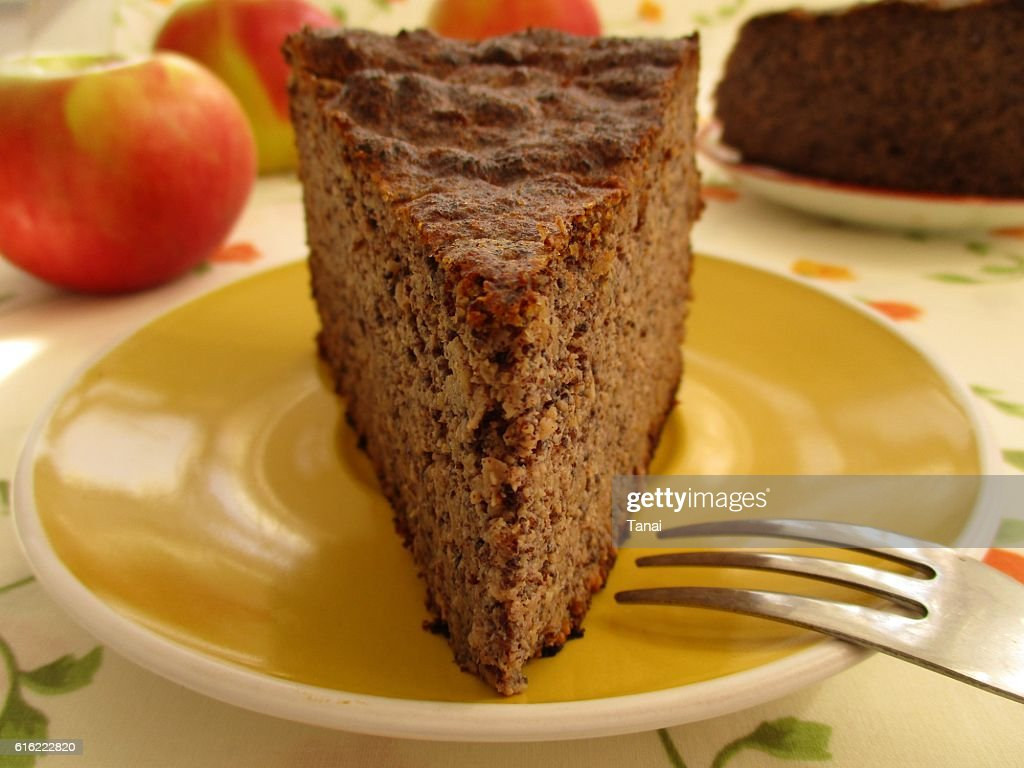 Gluten free apple cake with poppy seeds on yellow plate : Stock Photo
