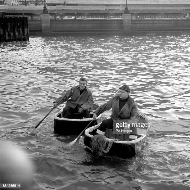 Glyn Elias and his cousin Raymond Rees from Carmarthenshire in Wales manoeuvre their coracles in the River Thames They have been brought to London by...