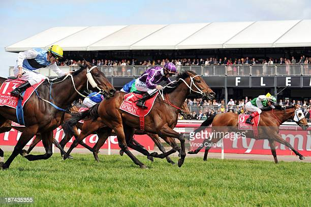 Glyn Schofield riding Boban defeats Jason Benbow riding Smokin' Joey and Craig Williams riding Speediness in Race 7 the Emirates Stakes during Stakes...