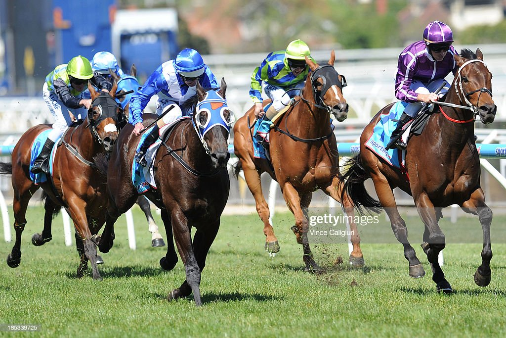 Glyn Schofield riding Boban (r) defeats Luke Nolen riding Strawberry Boy in the Sportingbet Moonga Stakes during Caulfield Cup day at Caulfield Racecourse on October 19, 2013 in Melbourne, Australia.