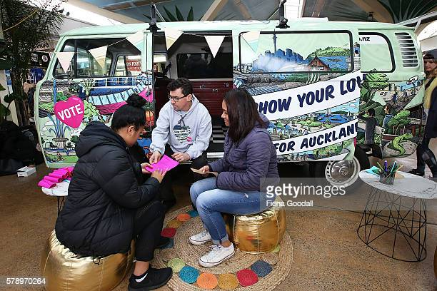 Glyn Walters Auckland Council Elections Planning Manager and students Honeofaefita Taungapeau and Meliana Minoteti with the Love Bus at Mangere Town...