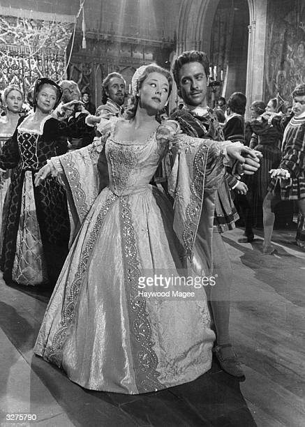 Glynis Johns and Richard Todd dance a quadrille at the May Day ball at Windsor castle in a scene from the film 'The Sword And The Rose' the story of...