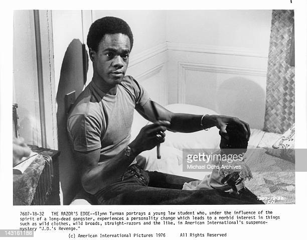 Glynn Turman holding razor and doll in a scene from the film 'JD's Revenge' 1976