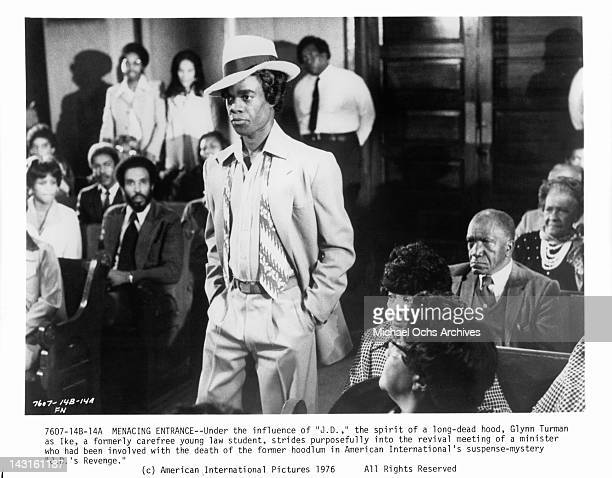 Glynn Turman strides purposefully into the revival meeting of a minister in a scene from the film 'JD's Revenge' 1976