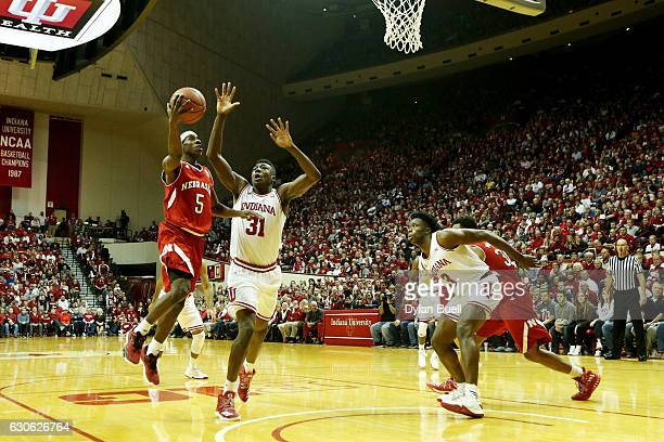 Glynn Watson Jr #5 of the Nebraska Cornhuskers attempts a shot past Thomas Bryant of the Indiana Hoosiers in the second half at Assembly Hall on...