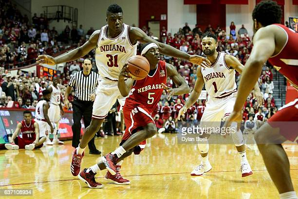 Glynn Watson Jr #5 of the Nebraska Cornhuskers dribbles the ball while being guarded by Thomas Bryant of the Indiana Hoosiers in the second half at...