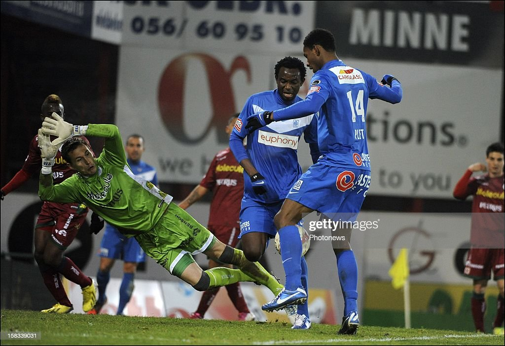 Glynor Plet of KRC Genk and Bennard Kumordzi of KRC Genk with goalkeeper Sammy Bossut of Zulte-Waregem during the Cofidis Cup 1/4 final away match between SV Zulte Waregem and KRC Genk in the Regenboog stadium on December 13, 2012 in Waregem, Belgium.