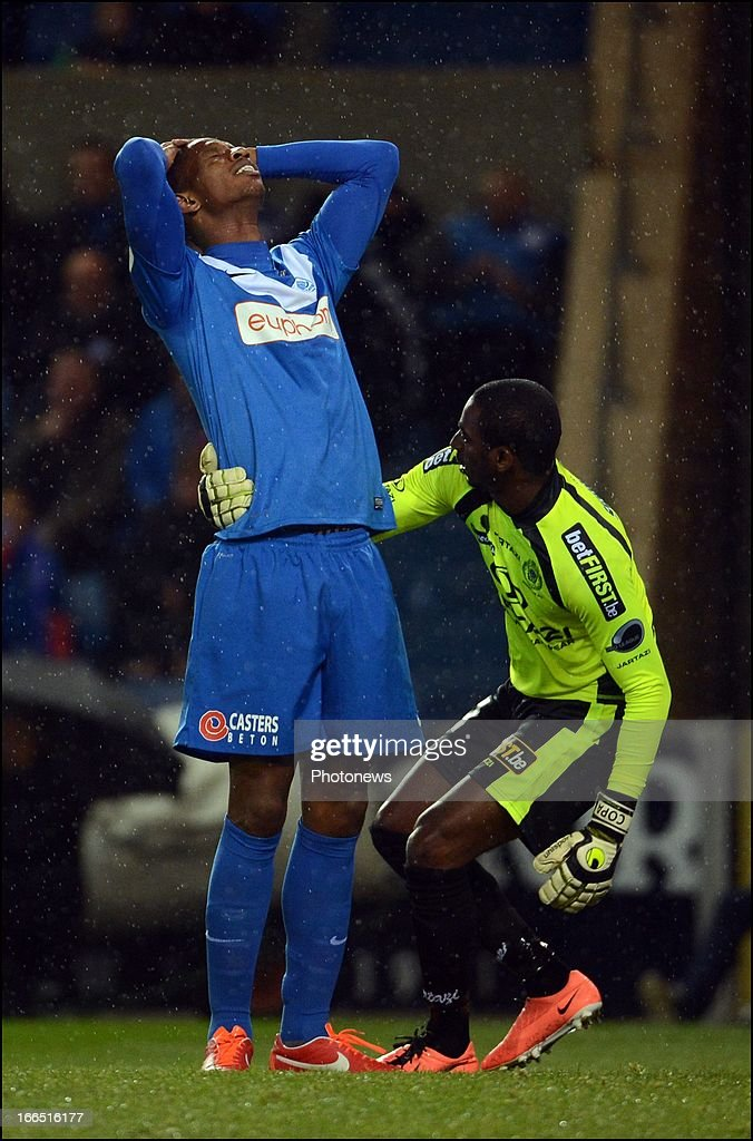 Glynor Plet of KRC Genk and goalkeeper <a gi-track='captionPersonalityLinkClicked' href=/galleries/search?phrase=Boubacar+Barry&family=editorial&specificpeople=550738 ng-click='$event.stopPropagation()'>Boubacar Barry</a> of Sporting Lokeren react during the Jupiler League Play off match between KRC Genk and Sporting Club Lokeren Oost-Vlaanderen on April 13, 2013 in Genk, Belgium.