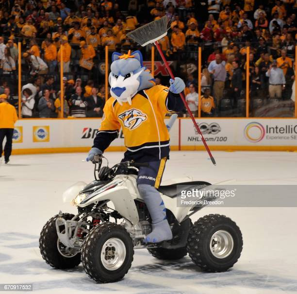 Gnash mascot of the Nashville Predators holds a broom after a Predators sweep of the Chicago Blackhawks in a 41 Predator victory in Game Four of the...