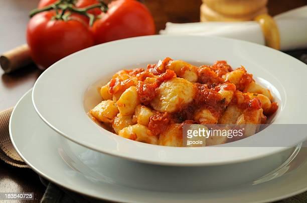 Gnocchi in a white bowl with tomato sauce