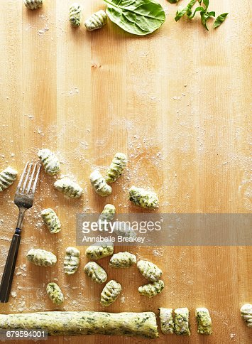 Gnocci preparation on a light wooden surface