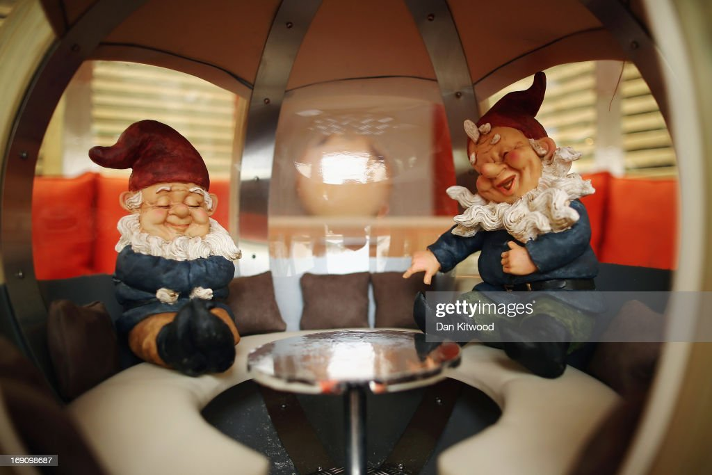 Gnomes sit on a stand at the Chelsea Flower Show on May 20, 2013 in London, England. The Royal Horticultural Society (RHS) has lifted a ban on gnomes for this year only. The gnomes will be auctioned off as part of the 'Chelsea Centenary Appeal', and to raise funds for the RHS Campaign of School Gardening. The Chelsea Flower Show run by the RHS celebrates its 100th birthday this year.