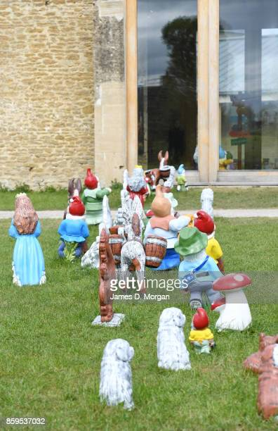 Gnomes walking across Lawn to enter house part of an exhibition by Djordje Ozbolt's showing at Hauser and Wirth in Burton United Kingdom in April...