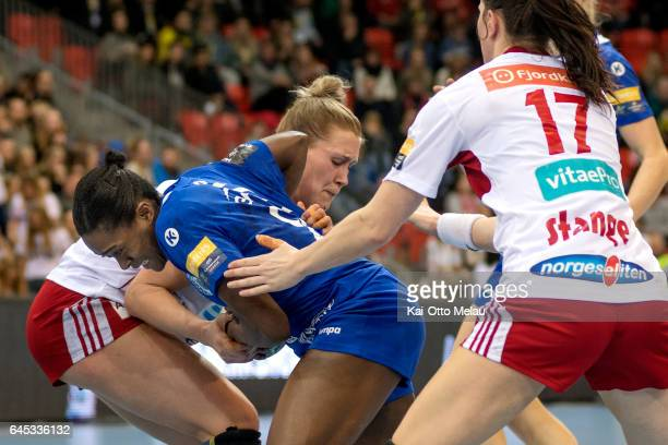 Gnonsiane Niombla wrestles with Marit Malm Frafjord in the Women's EHF Champions league match between Larvik HK and CSM Bucuresti on February 25 2017...