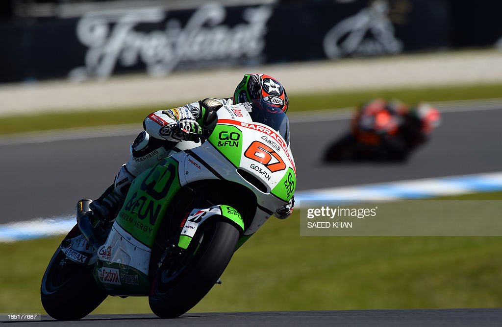 Go and Fun Honda Gresini motoGP's Australian rider Bryan Staring powers his bike during the second practice session of the Australian MotoGP Grand Prix at Phillip Island on October 18, 2013. AFP PHOTO/ Saeed KHAN USE