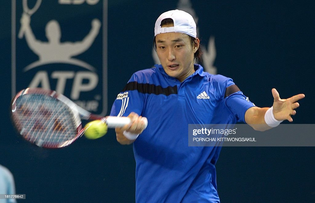 Go Soeda of Japan hits the ball as return to Feliciano Lopez of Spain during the second round of Tennis ATP Thailand Open 2013 tournament in Bangkok on September 25, 2013.