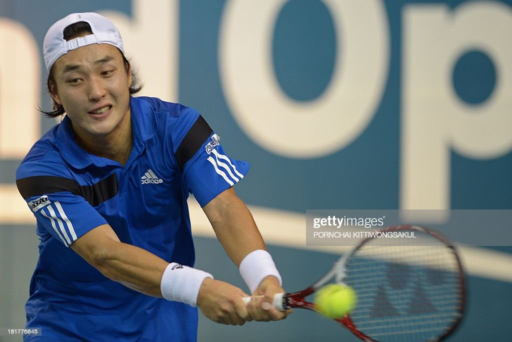 Go Soeda of Japan hits the ball as return to Feliciano Lopez of Spain during the second round of Tennis ATP Thailand Open 2013 tournament in Bangkok on September 25, 2013. AFP PHOTO / PORNCHAI KITTIWONGSAKUL