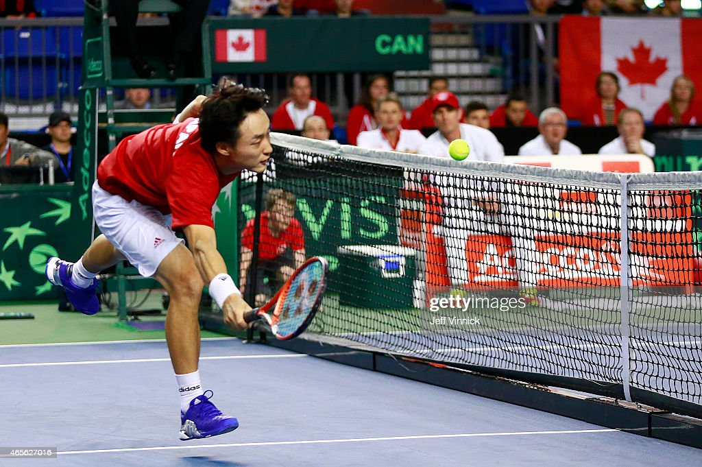 <a gi-track='captionPersonalityLinkClicked' href=/galleries/search?phrase=Go+Soeda&family=editorial&specificpeople=699644 ng-click='$event.stopPropagation()'>Go Soeda</a> of Japan hits the net as he misses a shot against Vasek Pospisil of Canada during their Davis Cup match March 8, 2015 in Vancouver, British Columbia, Canada.