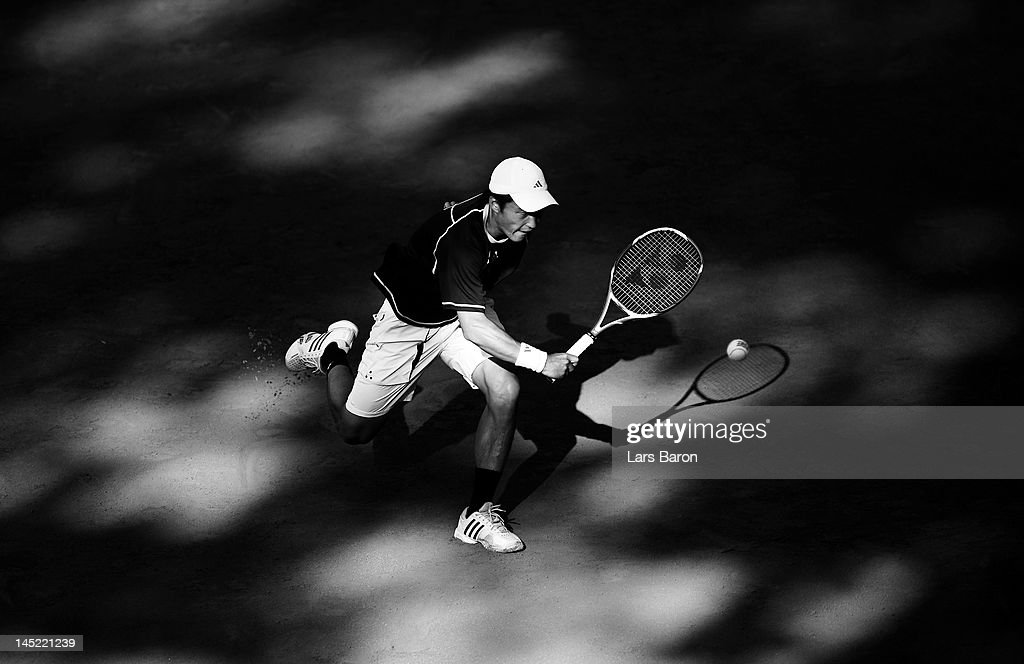 <a gi-track='captionPersonalityLinkClicked' href=/galleries/search?phrase=Go+Soeda&family=editorial&specificpeople=699644 ng-click='$event.stopPropagation()'>Go Soeda</a> of Japan plays a backhand during his match against Andy Roddick of USA during day five of Power Horse World Team Cup at Rochusclub on May 24, 2012 in Duesseldorf, Germany.
