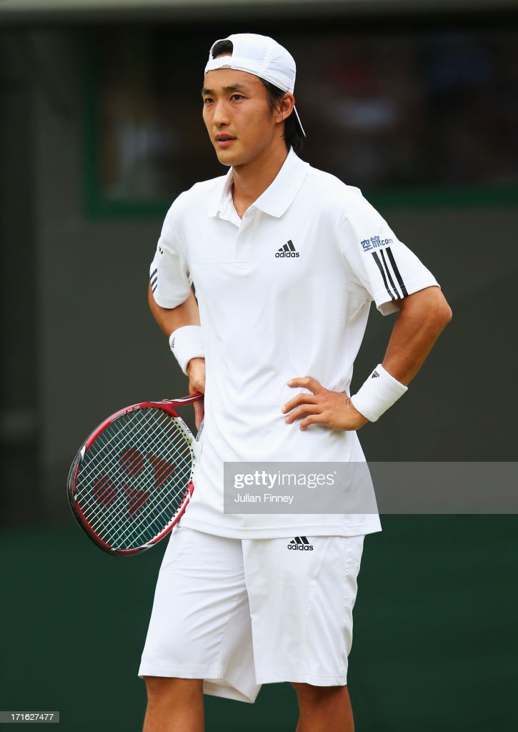 <a gi-track='captionPersonalityLinkClicked' href=/galleries/search?phrase=Go+Soeda&family=editorial&specificpeople=699644 ng-click='$event.stopPropagation()'>Go Soeda</a> of Japan reacts during his Gentlemen's Singles second round match against Richard Gasquet of France on day four of the Wimbledon Lawn Tennis Championships at the All England Lawn Tennis and Croquet Club on June 27, 2013 in London, England.