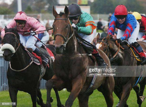 Go Tech ridden by David Allan centre wins the Garbutt and Elliott Handicap at York Races ahead of second placed Beat The Heat ridden by Leanne...