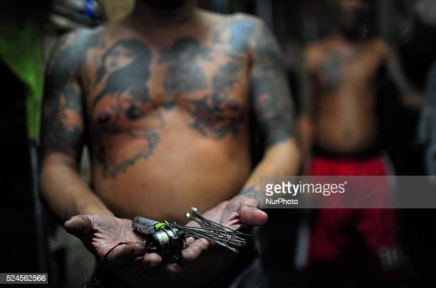 //nurphotocom/reportages/ to see more An inmate shows the tattoo maker that they are using made of homemade materials such as engine from a toy to...