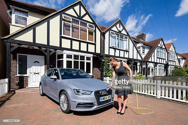 Go Ultra Low Audi A3 Sportback etron being charged on a London driveway on July 21 2015 in London England Ultralow emission vehicles such as this can...