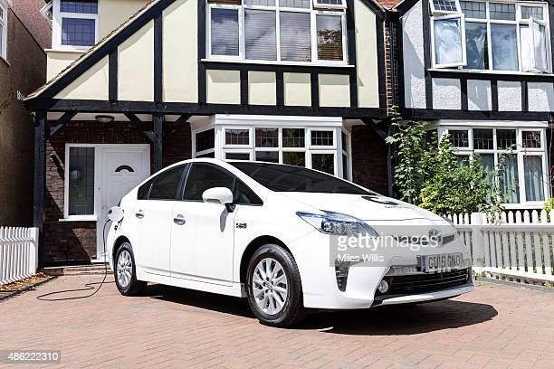Go Ultra Low Toyota Prius on charge on a London driveway on July 21 2015 in London England Ultralow emission vehicles such as this can cost as little...