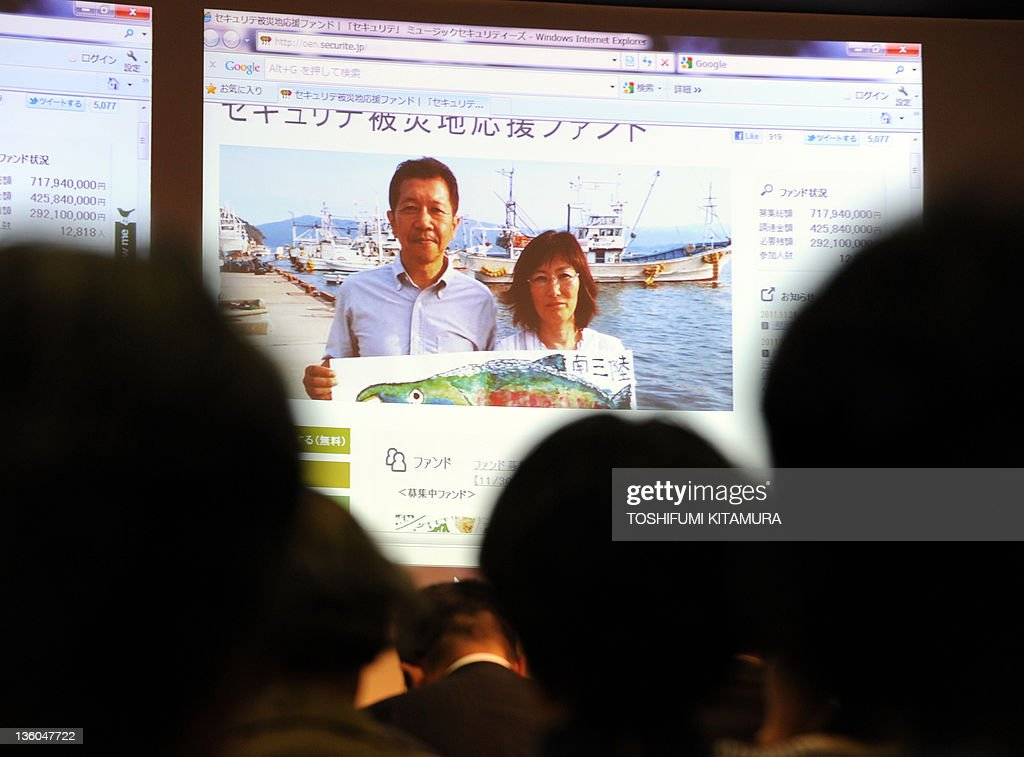 Go with 'Japan-disaster-quake-business-microfinance,FOCUS' by Hiroshi Hiyama Potential investors watch a screen homepage on Minamisanriku Ito Salmon Fund in Tokyo on November 30, 2011 while attending a briefing of the Music Securities' investment and donation of hopes for desperate Japanese families trying to rebuild their businesses destroyed by the March disasters. Music Securities, once specialising in raising capital for musicians, has created a scheme to bridge the tsunami-hit small businesses and good Samaritans in the rest of the country eager to help but don't know how best to donate their money.