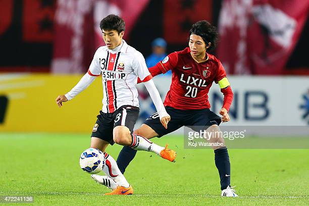 Go Yohan of FC Seoul and Gaku Shibasaki of Kashima Antlers compete for the ball during the AFC Champions League Group H match between Kashima Antlers...