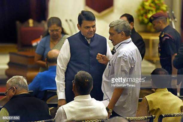 Goa Chief Minister Manohar Parrikar talking with Maharashtra chief Minister Devendra Fadnavis during the 13th VicePresident of India sworn ceremony...
