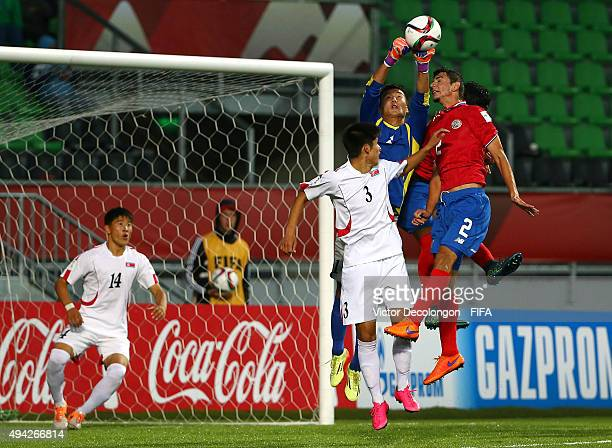 Goakeeper Ri Chol Song of Korea DPR punches the ball away from Diego Mesen of Costa Rica during the Costa Rica v Korea DPR Group E FIFA U17 World Cup...