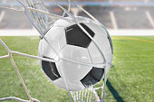 goal with a soccer ball in net at stadium