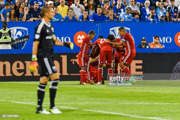 Goal celebration by FC Dallas player with Montreal Impact goalkeeper Evan Bush in the foreground goal scored by FC Dallas forward Cristian Colman...