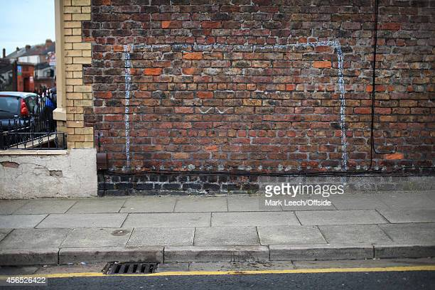 A goal drawn in chalk on the side of a house seen prior to the Barclays Premier League match between Liverpool and Everton at Anfield on September 27...
