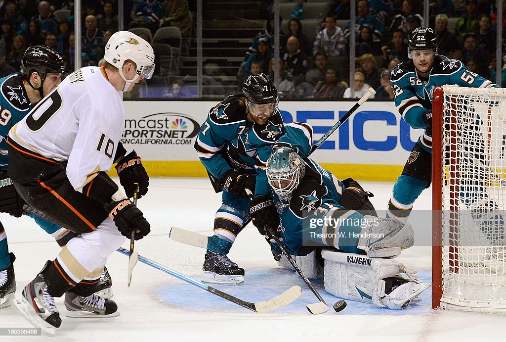 Goal Keeper Antti Niemi #31 sticks out his leg to block the shot of Corey Perry #10 of the Anaheim Ducks in the third period at HP Pavilion on January 29, 2013 in San Jose, California. The Sharks won the game in an overtime shoot-out 3-2.