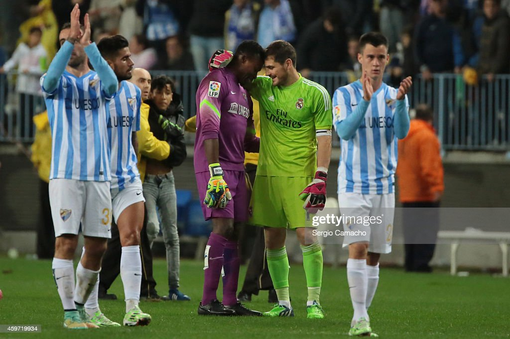 Goal keeper Carlos Kameni of Malaga CF greets goal keeper <a gi-track='captionPersonalityLinkClicked' href=/galleries/search?phrase=Iker+Casillas&family=editorial&specificpeople=215446 ng-click='$event.stopPropagation()'>Iker Casillas</a> of Real Madrid at the end of the La Liga match between Malaga CF and Real Madrid CF at La Rosaleda studium on November 29, 2014 in Malaga, Spain.