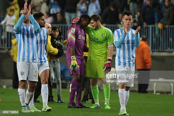Goal keeper Carlos Kameni of Malaga CF greets goal keeper Iker Casillas of Real Madrid at the end of the La Liga match between Malaga CF and Real...