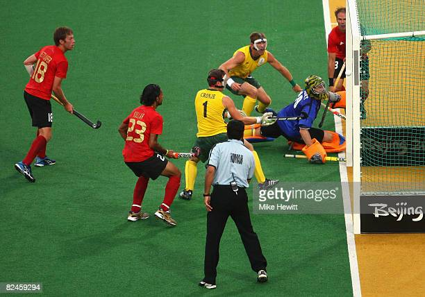 Goal Keeper Christopher Hibbert of South Africa watches the ball as it goes in for a goal during the pool match between South Africa and Canada in...