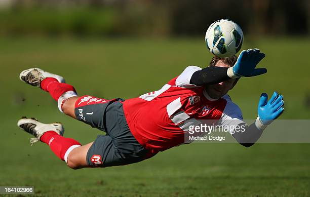 Goal keeper Clint Bolton dives to stop the ball during a Melbourne Heart ALeague training session at La Trobe University Sports Fields on March 20...