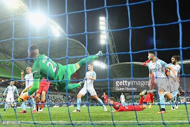 Goal keeper Dean Bouzanis of Melbourne City saves an attempt on goal by Ryan Kitto of United during the round four ALeague match between Melbourne...