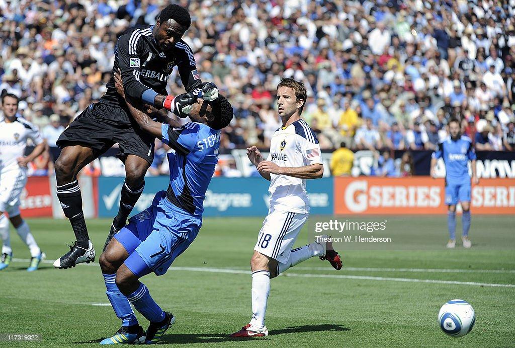 Goal Keeper Donovan Ricketts of the Los Angeles Galaxy runs into Khari Stephenson of the San Jose Earthquakes during an MLS soccer game at Buck Shaw...