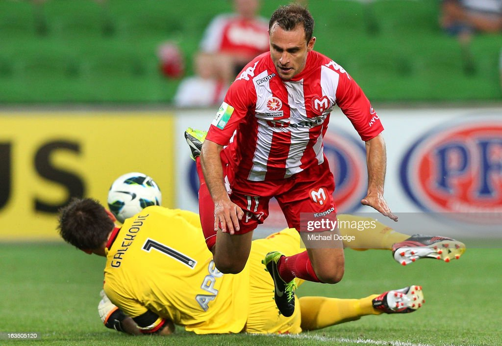 Goal keeper Eugene Galekovic of Adelaide United stops a goal attempt by Richard Garcia of the Heart during the round 24 A-League match between the Melbourne Heart and Adelaide United at AAMI Park on March 11, 2013 in Melbourne, Australia.