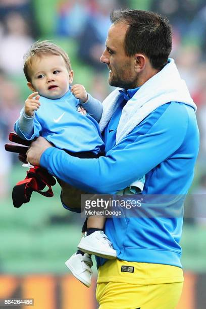 Goal Keeper Eugene Galekovic of the City enters the arena with his son during the round three ALeague match between Melbourne City and the Wellington...