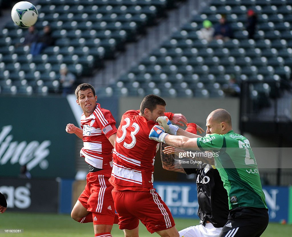 Goal keeper Ivan Turina #27 of AIK punches the ball away from Blas Perez #7 of FC Dallas and Kenny Cooper #33 of FC Dallas during the first half of the game at Jeld-Wen Field on February 17, 2013 in Portland, Oregon.