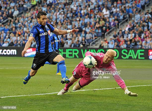 Goal keeper Jimmy Nielsen of Sporting Kansas City save a shot on goal from midfielder Felipe Martins of the Montreal Impact during the first half on...